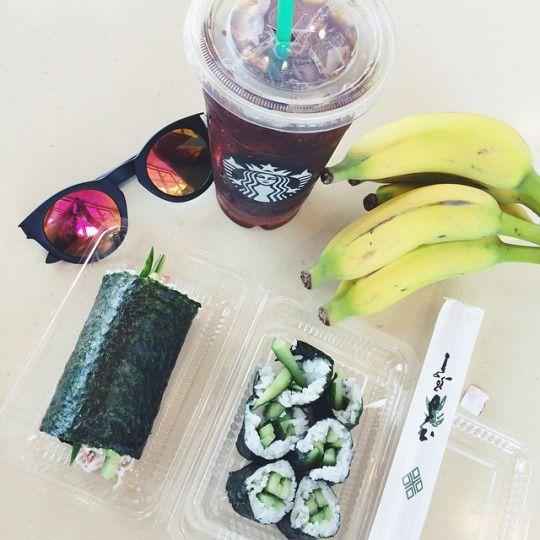 seaweed, rice, and avocado sushi with bananas and a starbucks drink