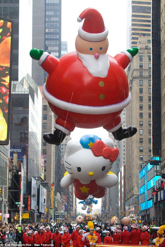 Macy's Parade...I got to go one year and it rained but I didn't let it rain on my parade...giggle...got lotza umbrella pics too...