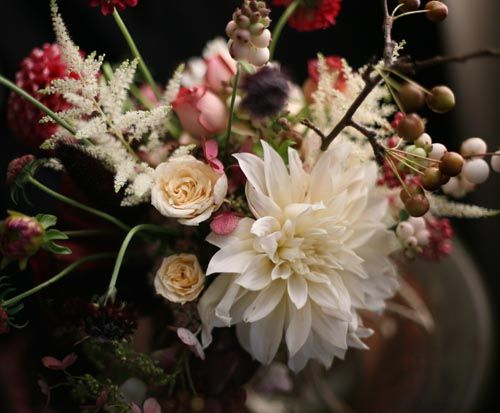 Love the rustic elegance of this arrangement.