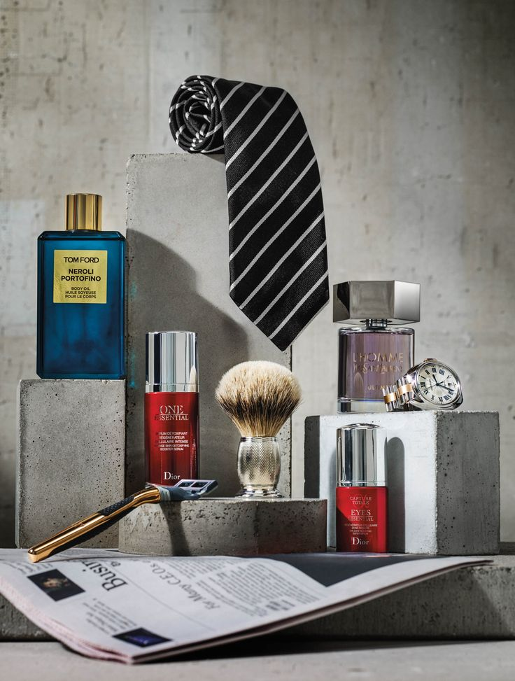 <strong>THE FINANCIER</strong> CLOCKWISE FROM TOP: TOM FORD TIE, YVES SAINT LAURENT L'HOMME ULTIME EAU DE PARFUM, CARTIER CLE DE CARTIER WATCH, DIOR ONE ESSENTIAL EYE SERUM, ART OF SHAVING ENGRAVED SILVERTIP SHAVING BRUSH, HARRY'S 18K ROSE GOLD RAZOR, DIOR ONE ESSENTIAL INTENSE SKIN DETOXIFYING BOOSTER SERUM, TOM FORD NEROLI PORTOFINO BODY OIL