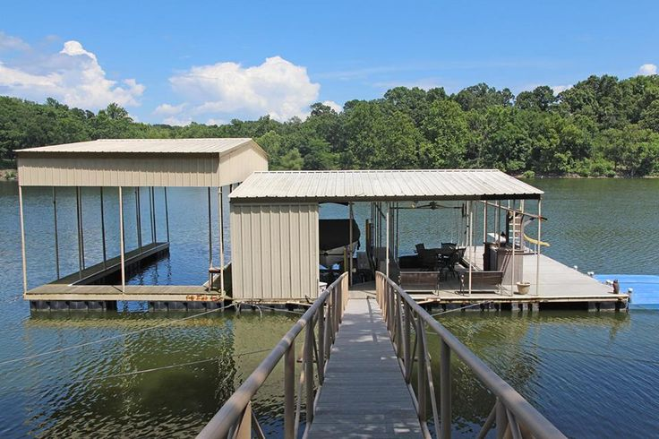 What a great lakefront home! Located in the deep waters of popular Ketchum Cove, this home offers 3 bedrooms, 2 bathrooms, a fireplace, two living areas, a master suite and huge 3-slip boat dock! The boat dock has 50-ft., 30-ft. and 17-ft. boat slips, a water slide, built-in bar and 2 PWC (personal watercraft) ports! Located just a few minutes from town, the home is also close to many marinas and restaurants by water.