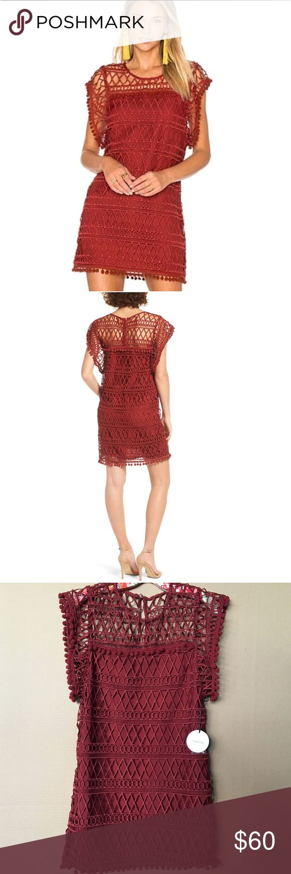 """Tularosa """"Clayton"""" tunic mini dress -- BNWT Playful pompoms dance along the edges of this short shift dress made from beautiful brick-colored lace. Features relaxed fit, round sheer neckline, exaggerated flutter sleeves, partial lining & back button closures. 17"""" waist, 17 1/2"""" waist, 18 1/2"""" hips, 31 1/2"""" long. Color is Clay / Bordeaux. Polyester/elastane, hand wash. BNWT Tularosa Dresses Mini"""