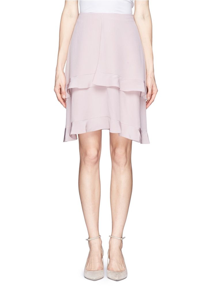 Known for its feminine aesthetics, Chloé reasserts its position with elegant Parisian fashion with this fluid silk skirt. Featuring fly away front flaps and a double-layer effect trimmed with delicate ruffles, this separates piece will finish your look with an effeminate overture for chic day-to-day styling.