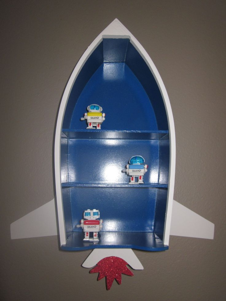 I made this spaceship for my son's room. I modified a rowboat shelf into a cute spaceship!