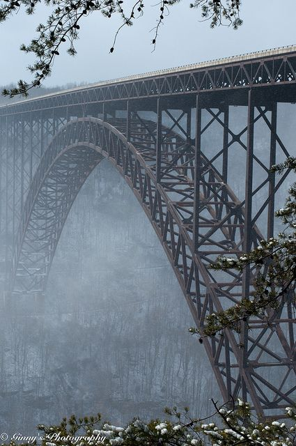 New River Gorge Bridge This bridge is 876 feet high and is the second longest steel arc bridge in the world. On the 3rd Saturday in October, the bridge is shut down and people rappel or BASE jump off of it. It's the only day that you are allowed to walk across the bridge.