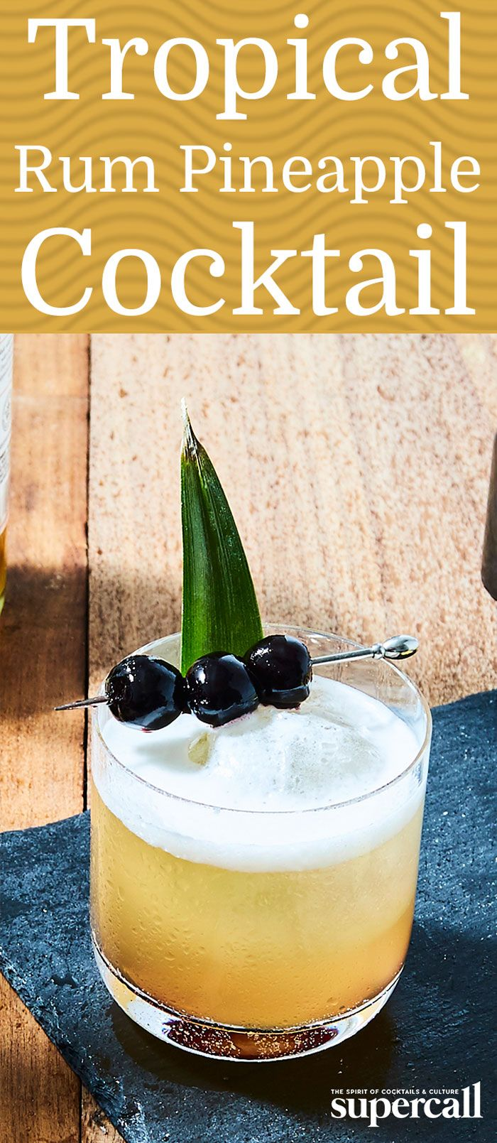 Nothing conjures thoughts of beach breezes quite like a cocktail made with rum and fresh pineapple juice. But the mix isn't just a summertime drink, especially when you add ingredients that'll spice it up. The libation is finished with bitters and a skewer of brandied cherries, and we suggest sipping it by the fire while dreaming up your next tropical getaway.