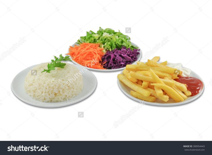 plate of french fries salad with olives white rice on white background.background, chip, cooked, fast, fat, food, french, fresh, fried, green, group, heap, herb, junk, leaf, pile, plate, portion, potato, prepared, salty, shot, snack, square, studio, unhealthy, white, yellow