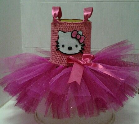 Hello Kitty tutu dress. Hand crocheted tutu dress with stretvh yarn, and hot pink glitter tulle skirt. Adjustable satin ribbon shoulder straps