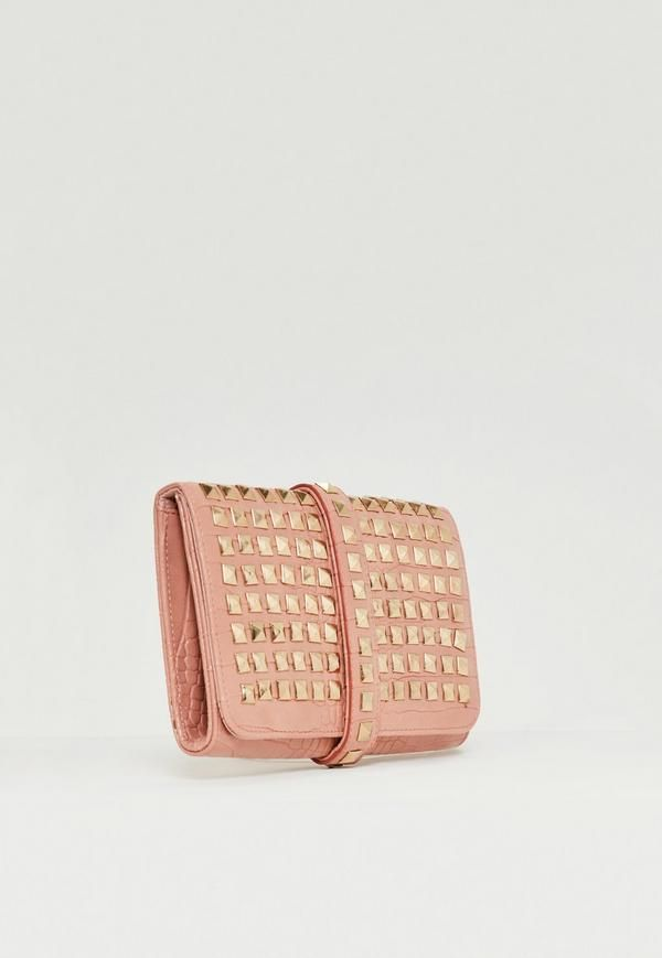 Go for this blush pink studded clutch bag with chain strap and steal the scene