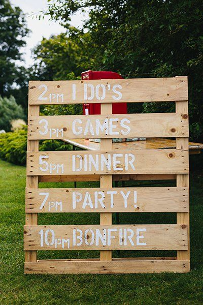 This sign made of plywood has a country feel. You can't miss a wedding itinerary when it's displayed this big!Related:75 Ideas for a Rustic Wedding
