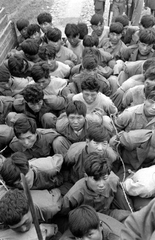 Rebels in army uniforms are trussed in army trucks after capture by loyal army forces, for trial by Korean military tribunal. Communist October 1948 Yeosu-Suncheon Rebellion. Carl Mydans- Time  Life Pictures. Not published.