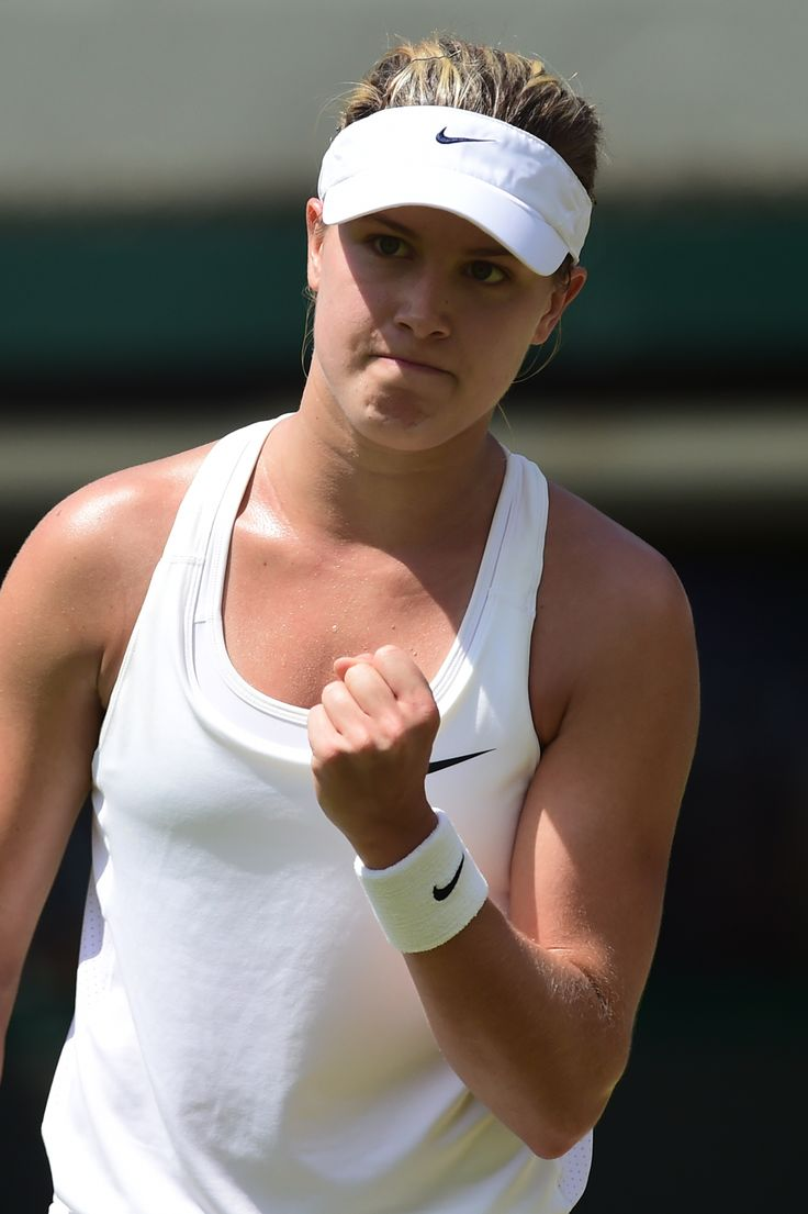 Canada's Eugenie Bouchard reacts to a point against Germany's Angelique Kerber during their women's singles quarter-final match on day nine of the 2014 Wimbledon Championships at The All England Tennis Club in Wimbledon, southwest London, on July 2, 2014. AFP PHOTO / CARL COURT