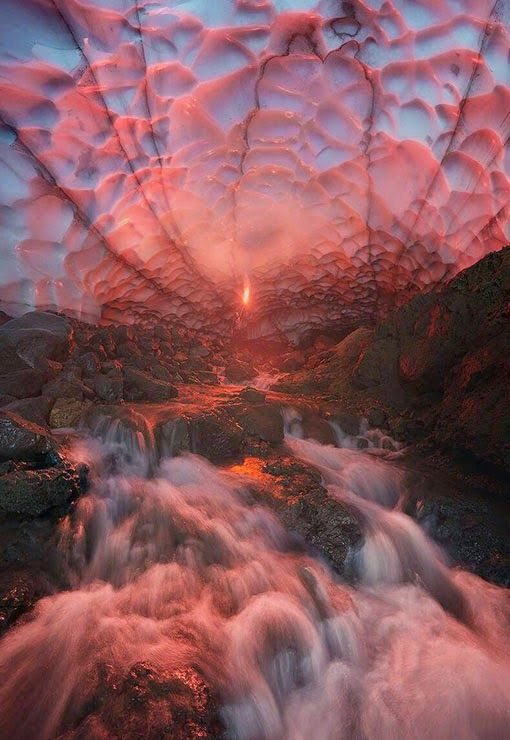Sunset through an ice cave under a glacier in Russia