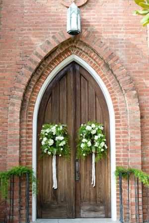 church door wreathes with greens banisters. classic southern, beautiful