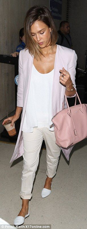 Pretty pastels:The 34-year-old actress-turned-CEO trekked through the travel hub wearing ...