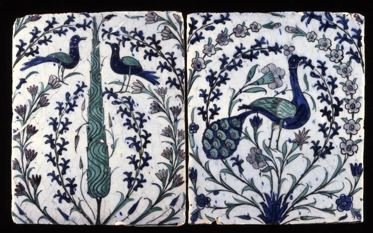 Tile. With a peacock. Made of green, blue, purple painted pottery.