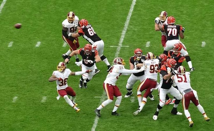 QB Andy Dalton steps up in the pocket and gets the pass away during the Washington Redskins @ Cincinnati Bengals game of the NFL London 2016 series.