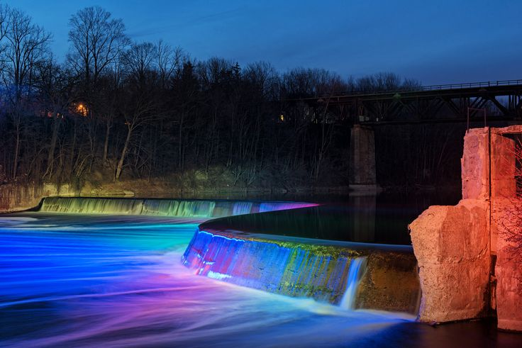 LUMENPULSE LIGHTING CONTROLS; TPL Lighting used RGBW Lumenbeam Grande luminaires to illuminate Penman's Dam in Paris, Ontario while limiting light trespass. The result is a dynamic lighting design that is visible from local bars and restaurants, adding a fresh face to an attraction that until now was only visible and photographed during the day • TPL LIGHTING • MERGING LIGHTING WITH DESIGN • TPLLIGHTING.COM • TORONTO, CANADA •
