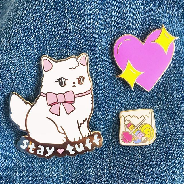 My new Stay Tuff pin (available now!) paired with a couple faves from my personal collection. 🐱💖🍬 (Artists have been tagged ✨)