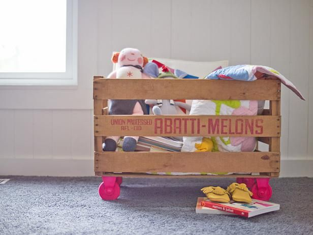 UPCYCLE PROJECT: Turn a fruit crate into a toy bin. You could also paint the crate!