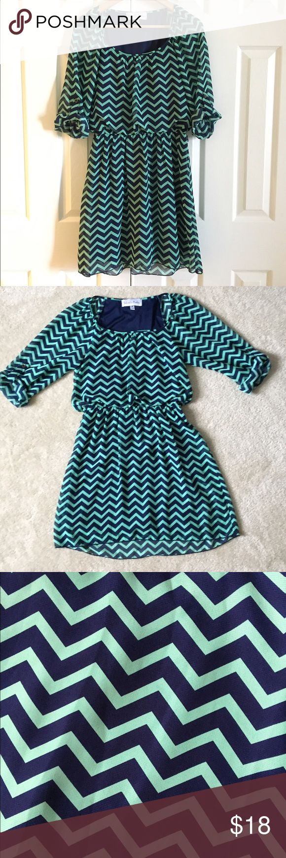 Gabriella Rocha green / blue chevron chiffon dress Gabriella Rocha blue and green chevron chiffon dress with 3/4 sleeves in great condition. Knee length, fits M size 6-10 Gabriella Rocha Dresses Long Sleeve