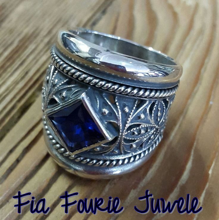 Quality craftsmanship and only the finest materials makes this blackened sterling silver ring a unique piece of wearable art. It has been handcrafted in fine artisan detail and features a blue cubic zirconia gemstone.