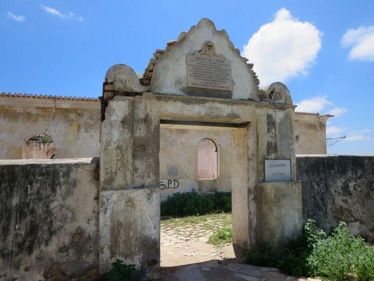"""The Reducto de Sao Pedro (1846) overlooks the Catumbela River crossing between Lobito and Benguela, Angola. The plaque over the entrance declares that the fort was a result of """"os continuos insultos feitos aos brancos pelos indigenas deste districto""""."""
