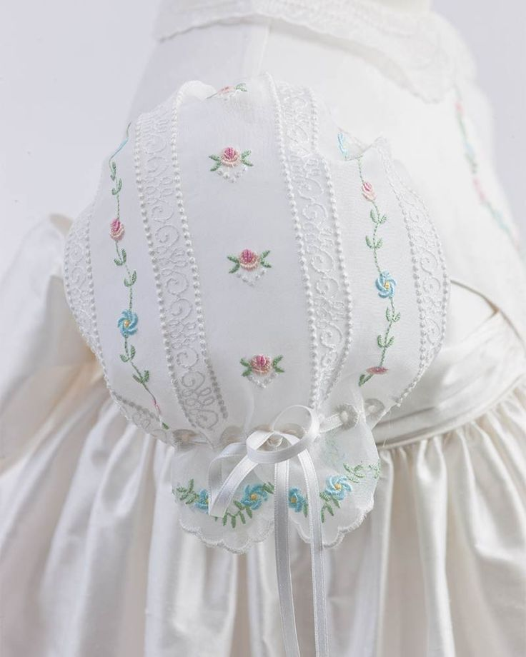 The flower girl dress shown is made with embroidery designs taken from Custom Keepsakes' Gals and Dolls Collection.