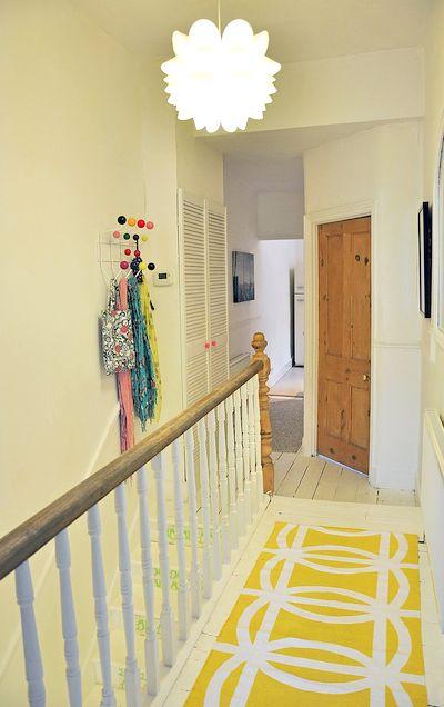 Hallway - white floorboards, stripped door