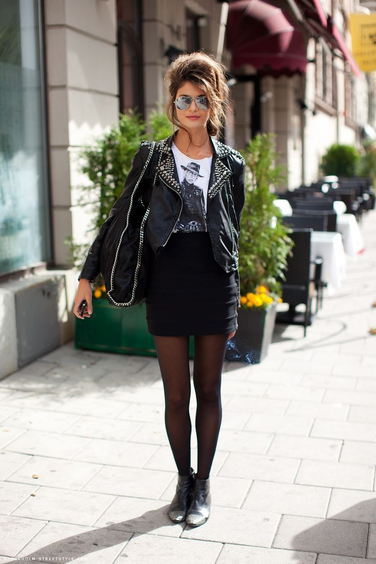 graphic white tshirt + black studded leather jacket + black tights + studded toe ankle booties + aviators