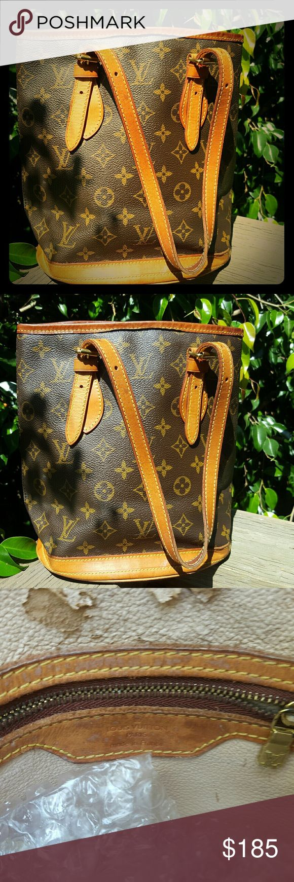 Louis Vuitton bucket bag p.m. in good condition outside but inside stickiness and peeling. Louis Vuitton Bags Shoulder Bags