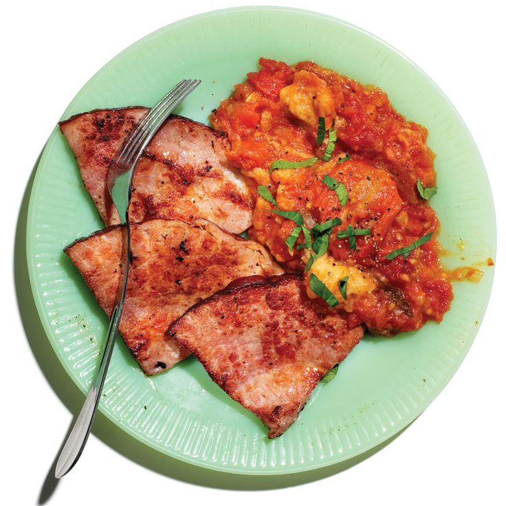 Stewed Tomatoes with Hamsteaks - Sweet, stewed tomatoes are the perfect foil for fried ham steaks.