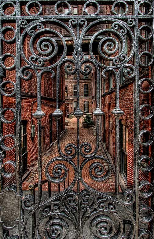 Thresholds:  Wrought-iron gate with spirals.
