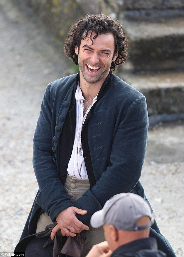 High spirits: The 32-year-old, who is reprising his role as brooding Captain Ross Poldark, was seen enjoying a few laughs with fellow cast and crew members