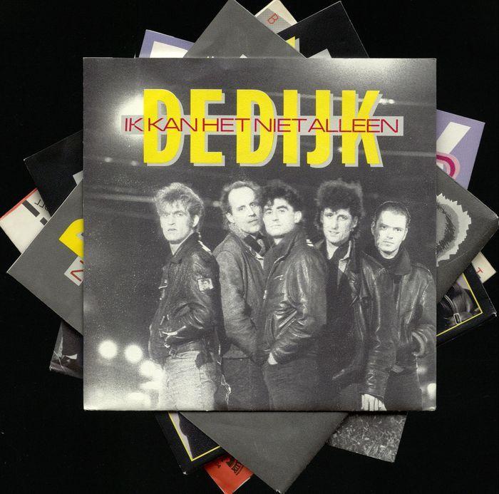 """Heleboel 18 singles van Nederlandse top banden De Dijk en Thé Lau de rockband The Scene  Heleboel 18 singles van Nederlandse top bands De Dijk en The SceneDe Dijk (Engels: The Dijk) is een Nederlandse rockband die in 1981 opgericht. De band is vernoemd naar de Zeedijk een straat in hun woonplaats Amsterdam. Hun muziek kan worden omschreven als een mix van soul blues en rock 'n roll met teksten gezongen alleen in het Nederlands behalve voor hun 2010 album Hold Tight en het liedje """"Genoeg is…"""