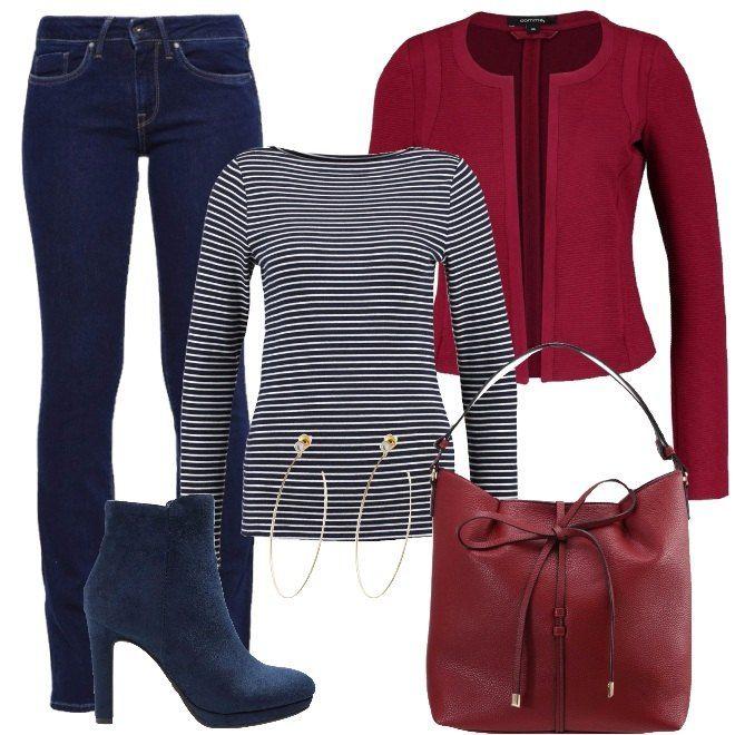 Il rosso ed il blu sono una tipica combinazione di colori primaverili e proposti in questo modo, sono perfetti per le veneri tascabili. I jeans blu scuro leggermente svasati, si abbinano ad una giacca rosso scuro, corta, senza bottoni e dal collo arrotondato. La maglia a maniche lunghe aderente è a righe blu e bianche. Completano il look, gli stivaletti con tacco alto, in tessuto blu, in modo da creare continuità con i jeans; la borsa rosso scuro e gli orecchini a cerchio, in metallo.