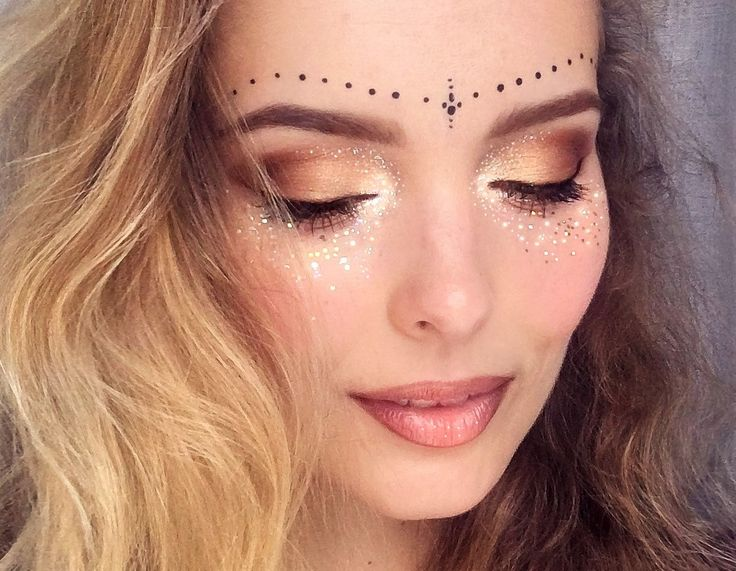 Get some inspiration on your festival looks for the summer music festivals coming up! Glitter freckles are the look of the summer.
