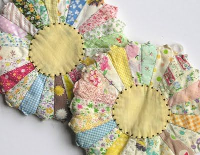 potholders from vintage material scraps. There is no pattern or tutorial, but maybe I can figure it out.