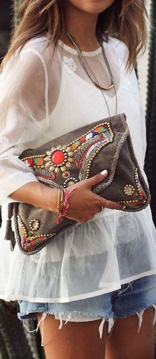 Sheer blouse and boho jeweled purse.