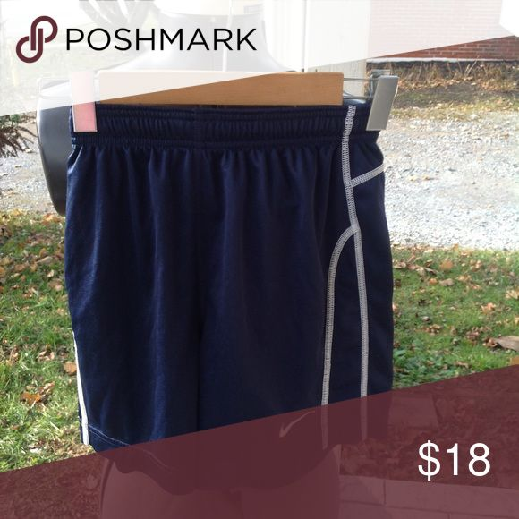 Boys Nike shorts. They are a size large, blue and white, in mint worn condition. Nike Bottoms Shorts