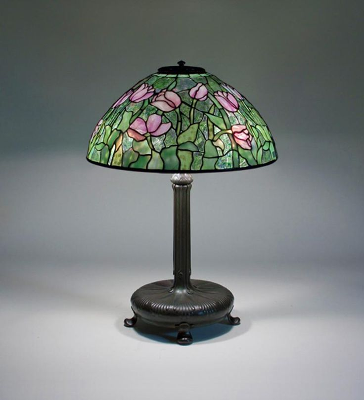 """Tiffany Studios New York """"Tulip"""" leaded glass and patinated bronze table lamp."""