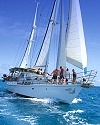 Sailing Whitsunday Islands Australia (similar ship - 68ft - past America's Cup Challenger) - Too Much Fun!