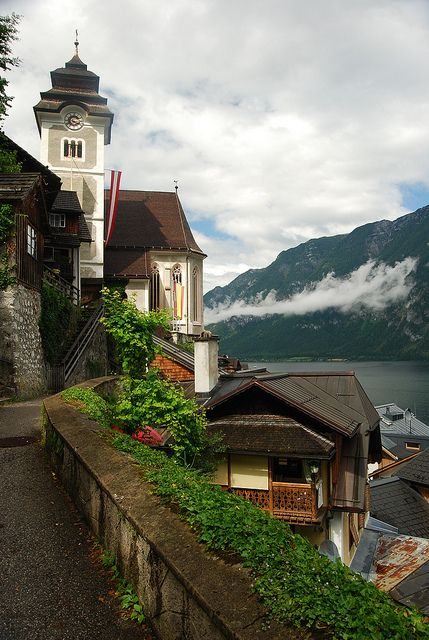 The catholic church perched above the village of Hallstatt, Austria (by knkppr).