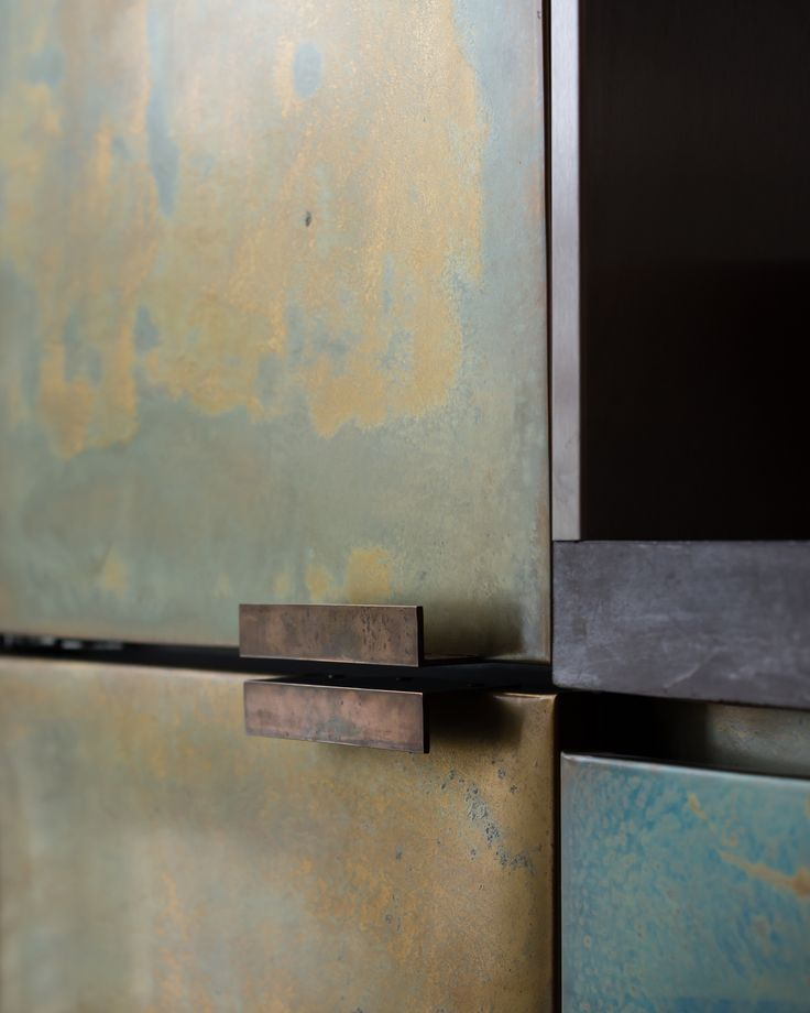 Refurbishment of terraced home in Belsize Park, London.   Materials. Patinated Brass. Detail. Joinery. Kitchen.   Interior Design.   Joinery by Goldcrest of London. Photographer - Jim Stephenson. Contractor - Mallett Construction.