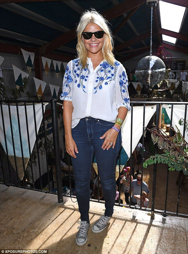 Stunning: The model, 35, opted for a casual look with blue jeans and a white floral-patterned shirt