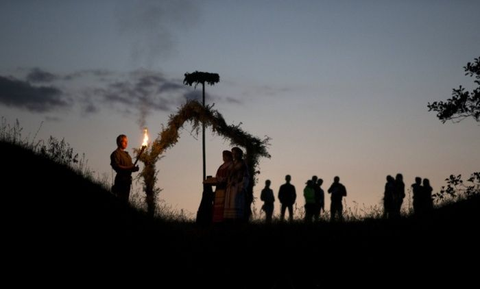 Rakov, Belarus -  People take part in the Ivan Kupala festival, originating from pagan times. They sing and dance around campfires, believing it will purge them of their sins and make them healthier -  Photograph: Vasily Fedosenko/Reuters