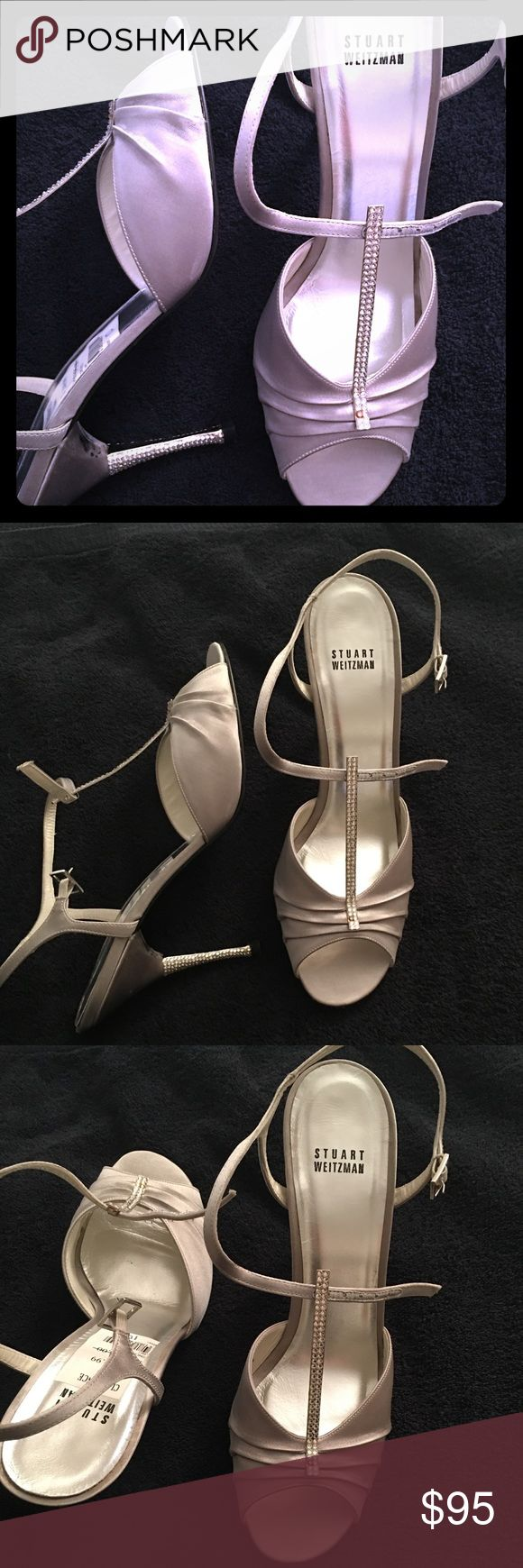 Stuart Weitzman Silver Rhinestone T-Strap Heels Stuart Weitzman Silver Silk & Rhinestone T-Strap Heels, size 10.  Possibly worn once.  A couple missing rhinestones on left t-strap.  Please see pics for any signs of wear.   Feel free to ask me any questions. Stuart Weitzman Shoes Heels