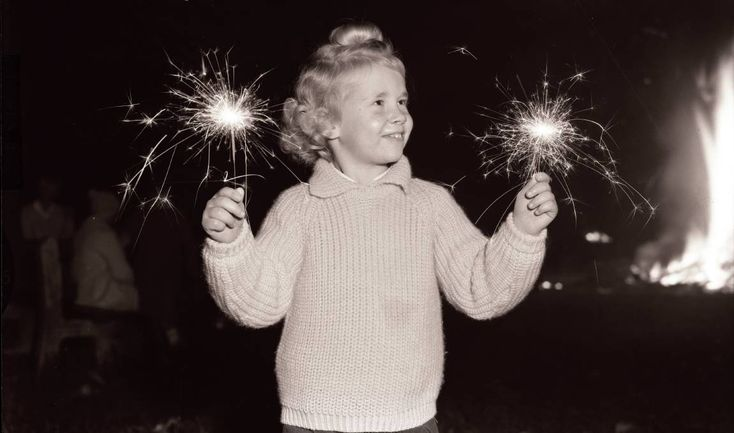 Yvonne Chladell of Bellevue Hill with sparklers on Bonfire Night in Waverley, May 14 1963. Photography by A. LINSEN, Fairfax Media.