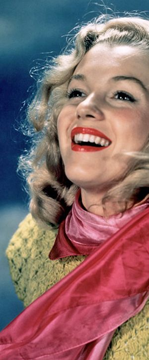 1946: Marilyn Monroe – Norma Jeane – wearing a green jumper and red scarf