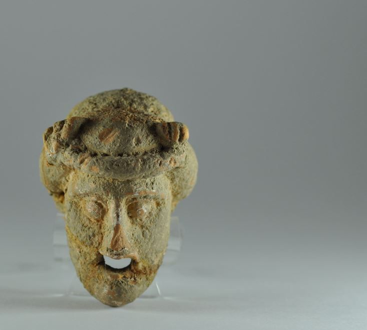Greek terracotta mask, 4th century B.C. Greek terracotta theater mask, due the small dimension is a Greek votive theater mask, 6.9 cm long. Private collection